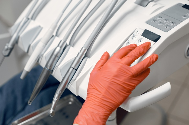 dentist-takes-instruments-doctor-protective-gloves-medic-uses-device_1157-40917.jpg